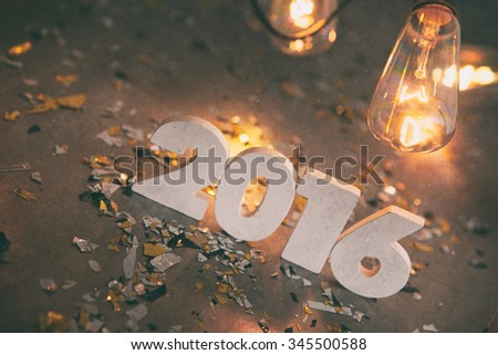 NYE: Happy 2016 With Retro Party Lights And Confetti - stock photo