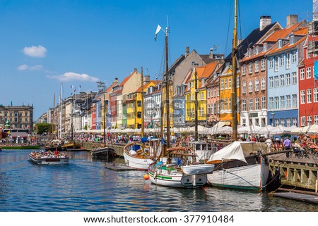 Nyhavn district is one of the most famous landmark in Copenhagen in a summer day, Denmark - stock photo