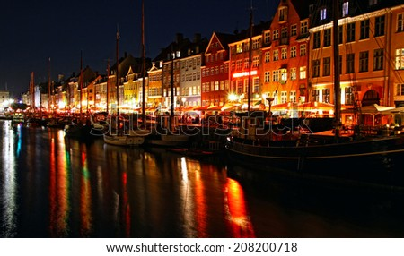 Nyhavn harbor in night, Copenhagen, Denmark. Nyhavn is a famous 17th century embankment, canal and entertainment area in Copenhagen - stock photo