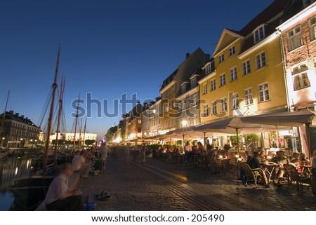 Nyhavn harbour by Night. Many bars and restaurants. Copehagen, Denmark - stock photo