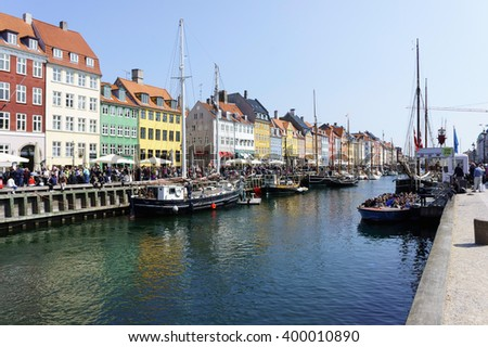 Nyhavn harbour, Copenhagen, Denmark.  Old Town of Copenhagen. Nyhavn district is one of the most famous landmark in Copenhagen. Scenic summer view of color buildings of Nyhavn in Copehnagen - stock photo