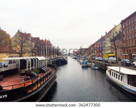 Nyhavn 17th century waterfront canal and entertainment district in Copenhagen, Denmark - stock photo