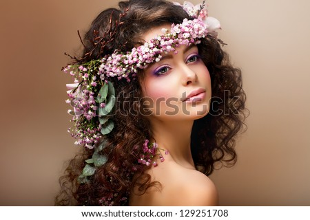 Nymph. Adorable Sensual Brunette with Garland of Flowers looks like Angel - stock photo