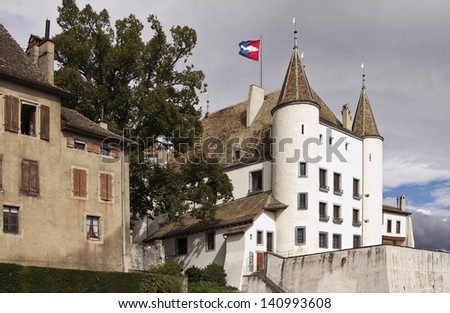 Nyon Castle is a 12th century fortress above Lake Geneva  - stock photo