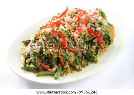 Nyona sayur paku stir fried young fern shoots with chopped onion and chili - stock photo