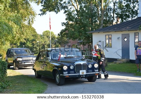 "NYORD, MOEN, DENMARK - SEP 06: ""Krone 1"" the queens automobile waiting for the queen at Queen Margrethe II and Prince Henrik visit at Moen at Queens Margrethes visit on September 6, 2013  at Moen, Denmark."