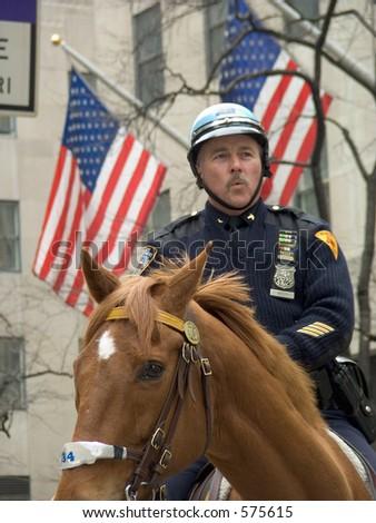 NYPD officer on horseback - stock photo