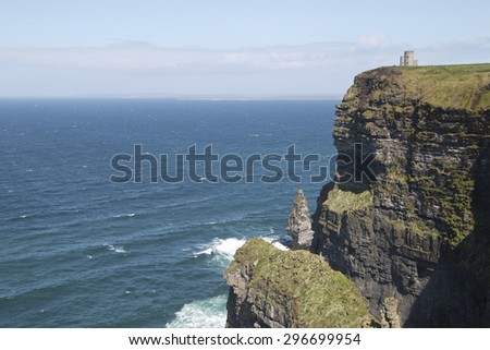 O' Briens Tower looks out over Atlantic Ocean atop Cliffs of Moher, County Clare, Ireland - stock photo