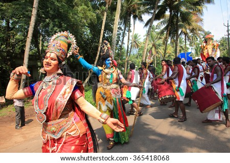 OACHIRA, INDIA - OCT 04 : Unidentified people dressed as a Hindu god Shiva and Parvati participate in the cultural procession during the temple festival on October 04, 2014 in Oachira, Kerala, India - stock photo