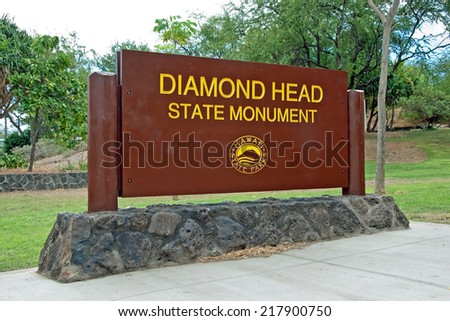 OAHU, HI - SEPTEMBER 19, 2011 - Diamond Head State Monument Park Sign on September 19, 2011 in Oahu. A 0,75mile hike leads to the edge of the crater´s rim. - stock photo