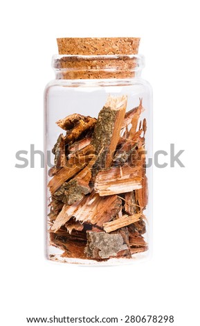Oak bark in a bottle with cork stopper for medical use. - stock photo