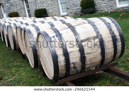 Oak barrels for aging whiskey or bourbon - stock photo