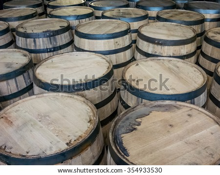 Oak barrels store bourbon whiskey for aging - stock photo