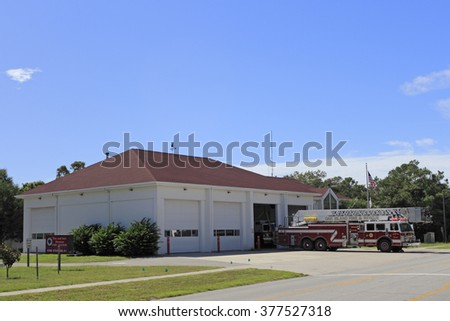 Oak Island, NC, USA - September 29, 2015:  This Fire Station at Ne 1St St & E Oak Island Dr has a ladder truck outside for maintenance. Oak Island Fire and Rescue Station.