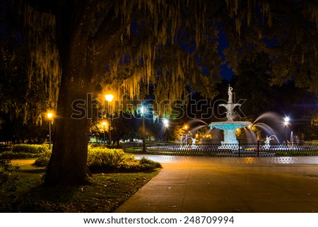 Oak tree and fountain at night in Forsyth Park, Savannah, Georgia.