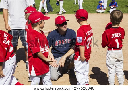 Oak View, California, USA, March 7, 2015, Ojai Valley Little League Field, youth Baseball, Spring, coach speaks to Tee-Ball Division players - stock photo