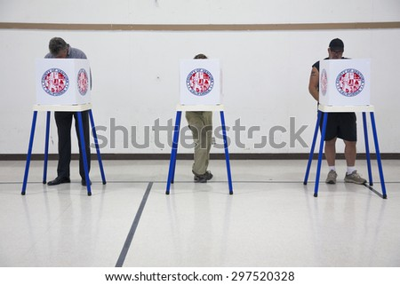 Oak View, California, USA, November 4, 2014, citizen votes in election booth polling station in gymnasium - stock photo