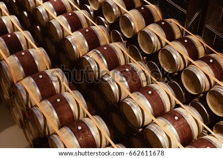 stacked oak wine barrels. Oak Wine Barrels Stacked In Modern Winery. View From Above