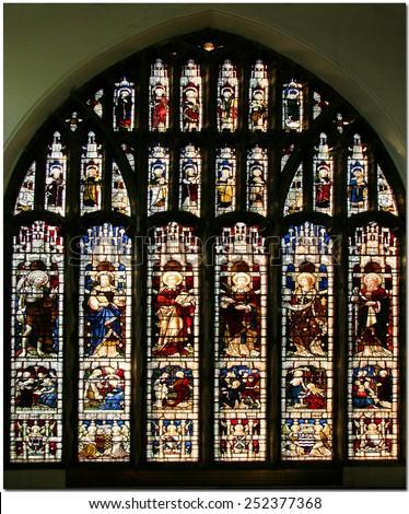 OAKHAM ENGLAND - DEC 12, 2005: Stained-glass window symbolizing, Henry VIII's royal power.  - stock photo