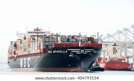 Oakland, CA - April 08, 2016: Cargo Ship MSC BRUNELLA arriving at the Port of Oakland. The Port of Oakland is the fifth busiest container port in the United States.
