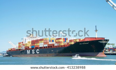 Oakland, CA - April 25, 2016: Cargo Ship MSC VERONIQUE entering the Port of Oakland. The cargo volume at the  Port of Oakland makes it the fifth busiest container port in the United States.