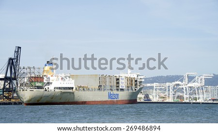 OAKLAND, CA - APRIL 13, 2015: Matson Cargo Ship MAUI entering the Port of Oakland. The Port of Oaklands cargo volume makes it the fifth busiest container port in the United States.