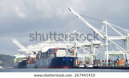 OAKLAND, CA - APRIL 06, 2015: The Port of Oakland loads and discharges more then 99 percent of containerized goods moving through Northern California, the nations fourth largest metropolitan area.