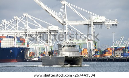 OAKLAND, CA - APRIL 06, 2015: U.S. Army Corps of Engineers vessel in the inner harbor of the Port of Oakland. The U.S. Army Corps of Engineers provides public engineering services in peace and war.