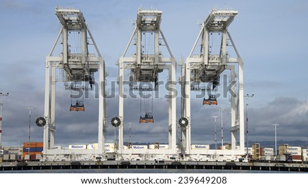 OAKLAND, CA - DECEMBER 21, 2014: Super Post Panamax cranes at the Port of Oakland. The giant cranes at the apex are roughly the height of a 24 story building and can weigh 1600 to 2000 tons each.