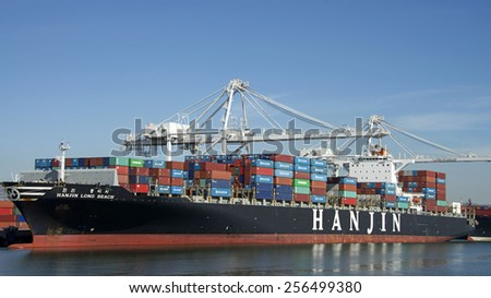 OAKLAND, CA - FEBRUARY 26, 2015: Hanjin Cargo Ship LONG BEACH docked at the Port of Oakland. Hanjin Shipping Co. Ltd is Korea's largest and one of the world's top ten container carriers.