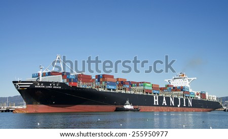 OAKLAND, CA - FEBRUARY 24, 2015: Hanjin Cargo Ship LONG BEACH entering the Port of Oakland. Hanjin is a large South Korean shipping company operating cargo vessels of all types all over the world.