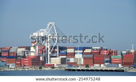 OAKLAND, CA - FEBRUARY 20, 2015: Thousands of backlogged shipping containers remain stacked at the Port of Oakland waiting to be transported by truck, rail or cargo ship.