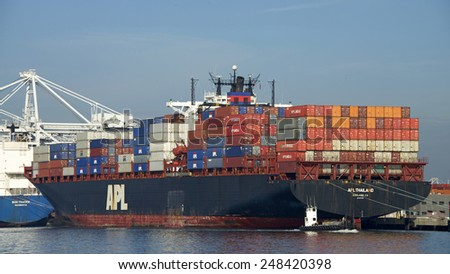 OAKLAND, CA - JANUARY 28, 2015: American President Lines Cargo Ship THAILAND at the Port of Oakland. APL is the world's seventh largest container transportation and shipping company.
