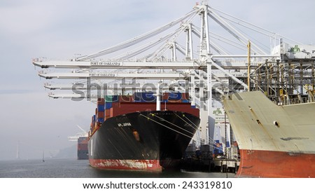 OAKLAND, CA - JANUARY 10, 2015:  American President Lines Ltd (APL) Cargo Ship JAPAN loading at the Port of Oakland. APL is the world's seventh largest container transportation and shipping company.