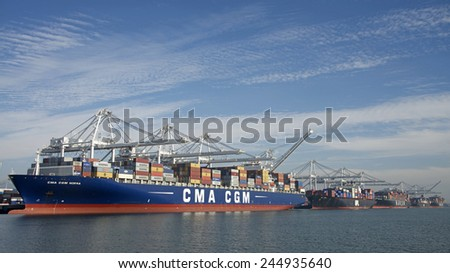 OAKLAND, CA - JANUARY 17, 2015: Five Cargo Ships from all over the world docked in the Inner Harbor at Port of Oakland, the fifth busiest port in the United States.