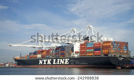 OAKLAND, CA - JANUARY 08, 2015: NYK Line Cargo Ship THEMIS loading at the Port of Oakland. Nippon Yusen Kabushiki Kaisha is one of the largest shipping companies in the world.