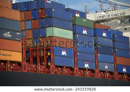 OAKLAND, CA - JANUARY 10, 2015: Rows of stacked shipping containers aboard APL Cargo Ship at the Port of Oakland. Most modern container ships can carry up to 16,020 twenty-foot equivalent units. - stock photo