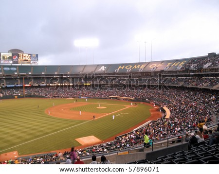 OAKLAND, CA - JULY 19: Red Sox vs. Athletics: Daisuke Matsuzaka lifts hands over head as he winds up for a pitch, whole field visible.  On July 19, 2010 Coliseum in Oakland California.