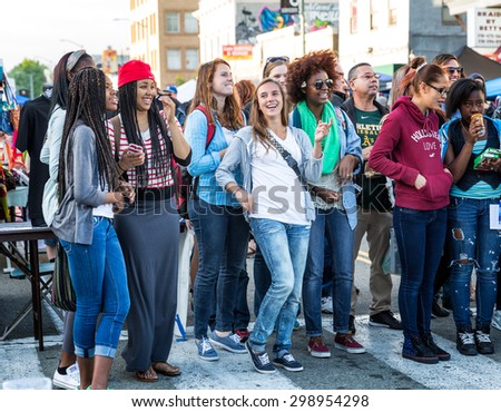 OAKLAND, CA-June 6, 2014: Diverse crowd of hipsters and artists having fun at the monthly Oakland Art Murmur street festival, which attracts visitors from all over the San Francisco Bay Area. - stock photo