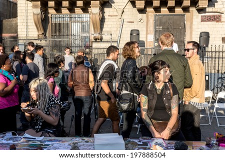 OAKLAND, CA-June 6,2014:The scene at the Oakland Art Murmur First Friday street festival in the Uptown district.The monthly art event draws crowds from all over the San Francisco Bay Area. - stock photo