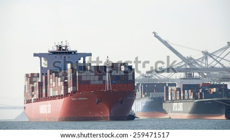 OAKLAND, CA - MARCH 09, 2015: Hamburg SUD Cargo Ship SANTA BARBARA entering the Port of Oakland. Hamburg Sud ranks among the worlds twenty largest container shipping lines.
