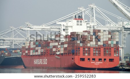 OAKLAND, CA - MARCH 10, 2015: Hamburg SUD Cargo Ship SANTA BARBARA loading at the Port of Oakland. Hamburg SUD is one of the key carriers on the North-South trade routes by ocean Transportation.