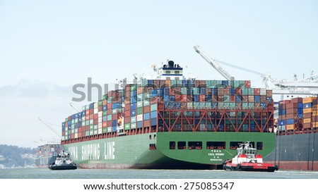 OAKLAND, CA - MAY 03, 2015: China Shipping Lines Cargo Ship CSCL SPRING entering the Port of Oakland. The Port of Oakland is the fifth busiest container port in the United States.