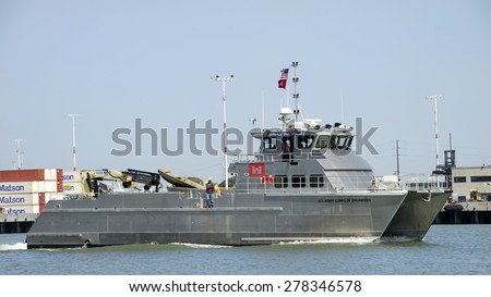 OAKLAND, CA - MAY 06, 2015: U.S. Army Corps of Engineers Vessel JOHN A.B. DILLARD JR  traveling through the middle harbor past the Port of Oakland..