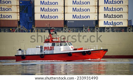 OAKLAND, CA - NOVEMBER 27, 2014: Pilot Vessel GOLDEN GATE in the Inner Harbor at the Port of Oakland en route to APL Cargo Ship PARIS. - stock photo