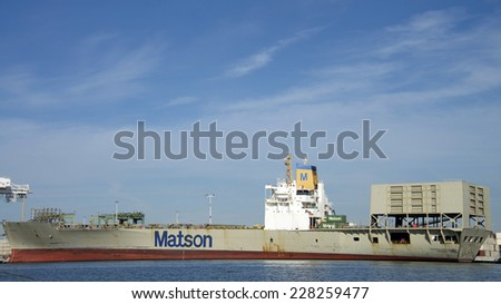 OAKLAND, CA - NOVEMBER 04, 2014: Port of Oakland, a Matson Cargo Ship remains docked for the past week.