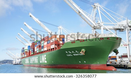 OAKLAND, CA - OCTOBER 10, 2015: China Shipping Lines Cargo Ship CSCL WINTER docked at the Port of Oakland. The Port of Oakland is the fifth busiest container port in the United States.