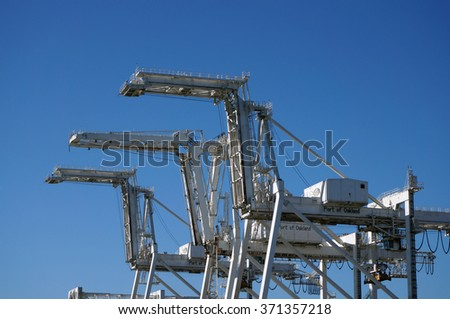 OAKLAND - OCTOBER 12: Close up of Row of large shipping crane featuring stairs leading up to higher sections with Port of Oakland written on side.  Oakland California on October 12, 2015. - stock photo
