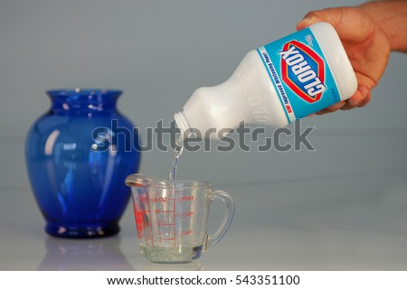 Pouring Bleach On Measuring Cup Stock Photo 286393496