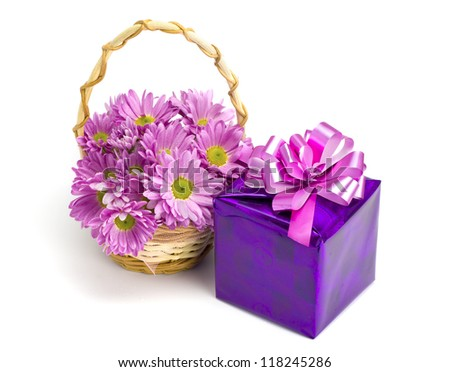 Oaklets in a basket and a gift on the white isolated background